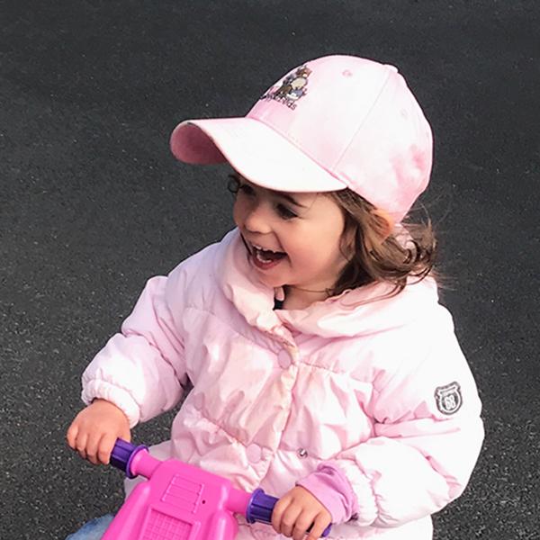 Girl wearing Little Aussie Snugglebuds baseball cap
