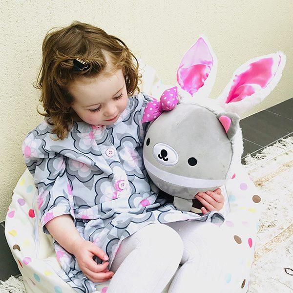 Girl holding Snugglebuds Thimble tassie devil jumbo plush squishy
